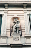 Statue on building facade Stock Photo