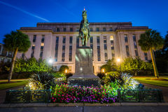 Statue and building at the State Capitol at night in Columbia, S Stock Photos