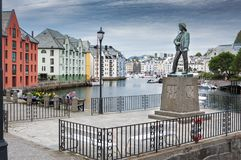 Statue and buildings in Alesund stock photography