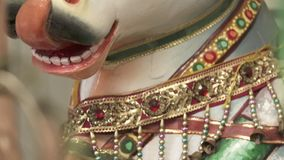 Statue of Bull Licking Lips. Handheld, close up shot of a statue of the bull Nandi, licking its lips stock footage