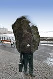 Statue of businessman with a rock for a head, Reykjavik, Iceland. Its Art Nouveau, is located in an alley a source image, a businessman. ... Puts on his head Stock Images