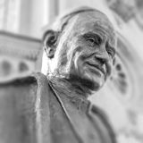 Statue bust of saint pope John XIII. Statue of Pope John XIII in Bergamo, Italy. Selected focus. Defocused blurry background Royalty Free Stock Photos