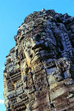 Statue- Cambodia. Gigantic face statues on the Bayon Temple in the walled city/ruin of Angkor Thom at the UNESCO World Heritage archaeological ruins of Angkor Royalty Free Stock Images
