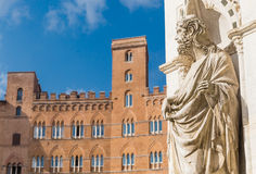 Statue of the Cappella di Piazza and Sansedoni Palace. Siena Stock Photos
