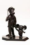 Cartoon characters.statuette. Metal statuette of cartoon characters.Cheburashka and Crocodile Gena.isolated on white background stock photo