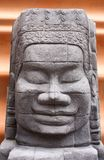 Statue carved from the rock face. Royalty Free Stock Photography