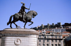 Statue and castle. Lisbon scene from Rossio of statue and St. Jorge castle stock photography