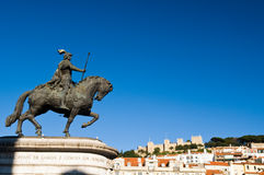 Statue and Castle, Lisbon, Portugal. Statue of King Joao I at Figueiroa Square, Lisbon, Portugal Royalty Free Stock Photography