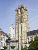 Statue and Cathedral of Mechelen, Belgium. Statue of Margaretha of Austria and the tower of the Saint Rombout cathedral in Mechelen, Belgium Stock Photos