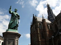 Statue and the Cathedral St. Bavo Royalty Free Stock Photos
