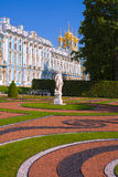 Statue and the Catherine Palace in a sunny weather. Landscape overlooking the palace – the summer residence of the Russian tsars Royalty Free Stock Image