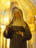 Statue of catholic nun inside church Stock Images