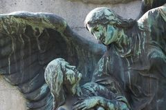 Statue of a celestial being/ Angel guiding a human. To heaven. Johnnisfriedhof, Dresden, Germany stock photography