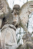 Statue in a cemetery. At fall Royalty Free Stock Photo