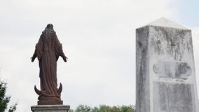 Statue in a cemetery on the sky.  stock video footage