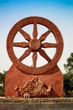 Statue of a chariot wheel with nice blue sky background Royalty Free Stock Image