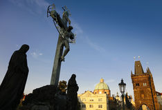 Statue at the Charles Bridge in Prague. Crucification statue at the Charles Bridge in Prague royalty free stock images