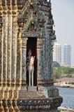 Statue in chedi in wat arun temple in bangkok. Statue of man and horse in chedi in wat arun temple in banngkok royalty free stock photo