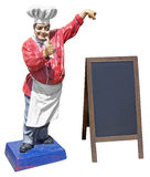 Statue of chef with menu board. Large plastic statue of chef with wooden menu blackboard isolated on white background Stock Image