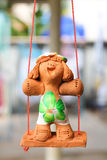Statue child smiling on a swing Royalty Free Stock Images