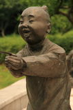 The statue of the child. The statue:a child on his face is plastered a grin of purest exhilaration stock images