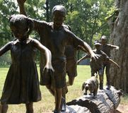Statue of Children on Log Royalty Free Stock Photos
