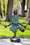 Statue of children palying and jumping Stock Images