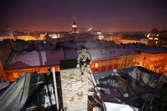 Statue of chimney sweep winter night Royalty Free Stock Images