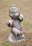 Statue of a Chinese boy. Royalty Free Stock Image
