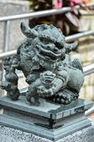 A statue of chinese imperial Lion Stock Photo