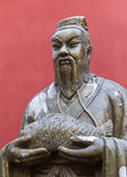 Statue of Chinese Man Holding Fish in Beijing Royalty Free Stock Photos