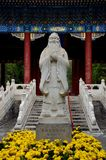 Statue of Chinese philosopher Confucius Beijing China. Beijing, China - October 21, 2015: A life size statue of Chinese wise man Confucius on a pedestal and Stock Photography