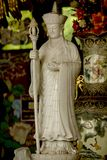 Statue of a Chinese priest Carved from white marble. stock photo