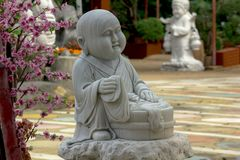 Statue of Chinese priest carved from white marble. royalty free stock photos