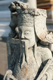 Statue of Chinese stone guardian at Wat Pho Temple. Thai traditi Royalty Free Stock Photo