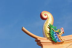 Statue on the Chinese temple roof. Colorful peacock statue of lime plaster to be adorned with sacred things Stock Photography