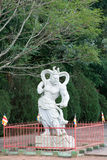 Statue of a Chinese warrior at the Buddhist temple Royalty Free Stock Image