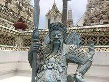 Statue of Chinese warrior at Wat Arun - Temple of Dawn. Wat Arun  & x22;Temple of Dawn& x22; is a Buddhist temple & x28;wat& x29; in Bangkok Yai district of Stock Images