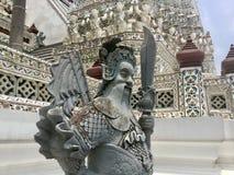 Statue of Chinese warrior at Wat Arun - Temple of Dawn. Wat Arun  & x22;Temple of Dawn& x22; is a Buddhist temple & x28;wat& x29; in Bangkok Yai district of Stock Photo