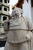 Statue Chinese at Wat Suthat in Bangkok Royalty Free Stock Photo