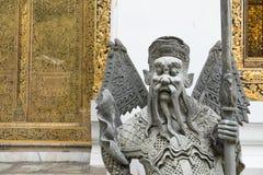 Statue chinoise de plan rapproché chez Wat Pho, temple à Bangkok Image stock