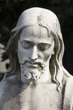 Statue of christ. In a cemetary in milan royalty free stock image
