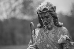 Statue of Christ on cementery. Statue of Christ with a lamb found in a cementery in Hot Springs Virginia Stock Images