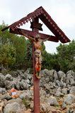 Statue of Christ on Cross at Medjugorje pilgrim site Bosnia Herzegovina. Medjugorje, Bosnia Herzegovina - March 26, 2015: At the top of a hill in the town of Royalty Free Stock Images