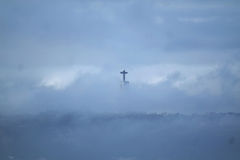 Statue of Christ the King in Lisbon through the clouds. Stock Images