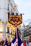 The statue of Christ leaving the church. The lead fraternity member holding a banner with SPQR on it during the procession of Nuestro Padre Jesús De La Salud Royalty Free Stock Photos
