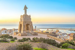 Statue of Christ staying above the Almeria city. Statue of Christ staying on the hill above the Almeria city on sunrise, Andalusia, Spain Royalty Free Stock Photos
