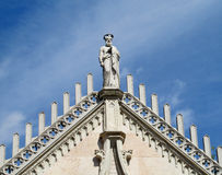 Statue of a christian saint on basilica roof Royalty Free Stock Images