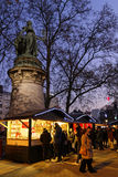 Statue and Christmas market Royalty Free Stock Photography