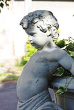 Statue of a chubby boy on a flower pot Royalty Free Stock Photo